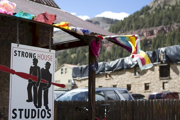 Buddhist prayer flags on art gallery in Colorado Rocky Mountain town